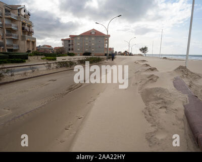 Street and pedestrian path covered, by the sand, after the passage of the storm 'Amelie' ( November 3, 2019) .Soulac-sur-Mer., Atlantic Coast. France - Stock Photo