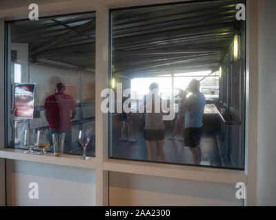 East Midlands, England, UK - August 4, 2018: Disgusting designated smoking area in a dirty cage for both cigarette and e-cigarette smokers (vapers) - Stock Photo
