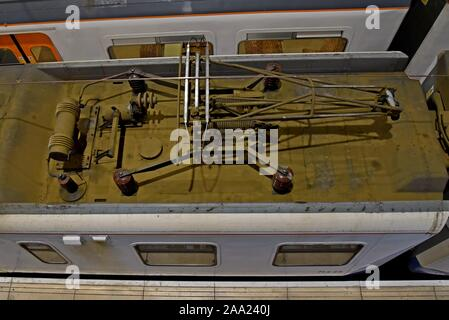View of an electric train pick up or pantograph at Liverpool Street Station, London - Stock Photo