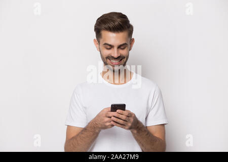 Close up portrait with handsome bearded man received good news. - Stock Photo
