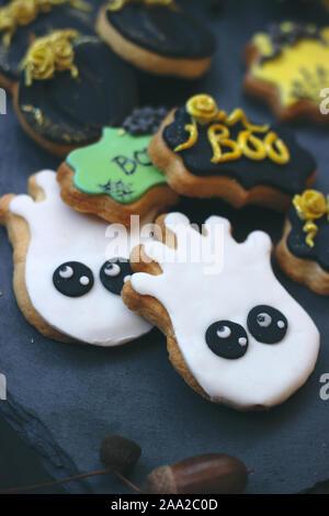 Homemade Halloween gingerbread cookies on dark background - Stock Photo