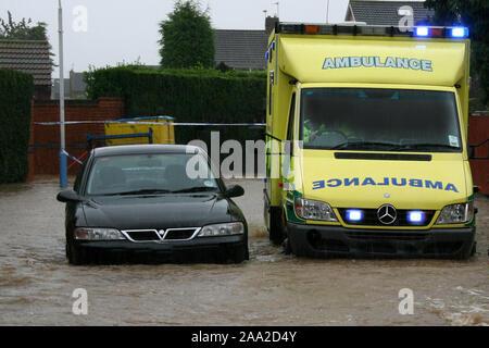 Ambulance in flood - Stock Photo