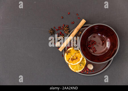 Cinnamon stick, star anise and orange slices on a plate Stock Photo