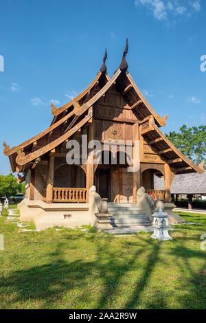 Wat Khuang Kom thai lanna wooden buddhist temple in Lampang, Thailand. - Stock Photo