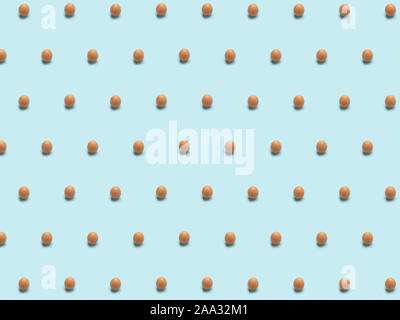 Eggs background, Isometric pattern photographed, Eggs's on a light blue background, wrapping paper, postcard, wallpaper, Minimal food concept design. - Stock Photo