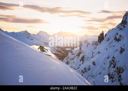 Man skiing in powder snow, Austrian Alps, Arlberg, Salzburg, Austria - Stock Photo