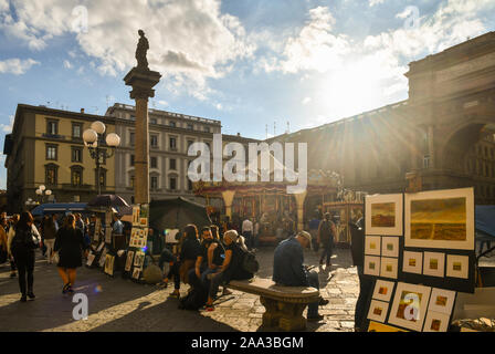 Backlight view of Republic Square in the historic centre of Florence with the Column of Abundance, the carousel and souvenir stalls, Tuscany, Italy