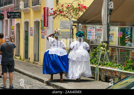 Two Baianas (women from Bahia) dressed in traditional clothes at Terreiro de Jesus Square - historic center of Salvador - Stock Photo