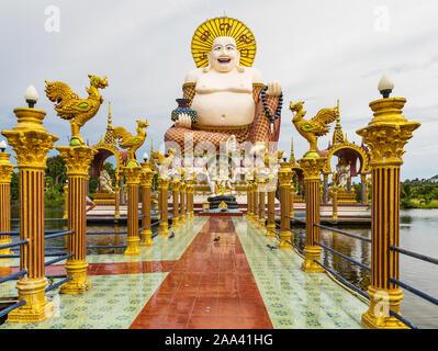 Wat Laem Suwannaram Chinese Buddhist Temple. Closeup of Giant statue of Budai against silver sky on Koh Samui. Thailand - Stock Photo