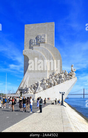 Tourists outside the Monument to the Discoveries by the Tagus River, Belem, Lisbon, Portugal. - Stock Photo