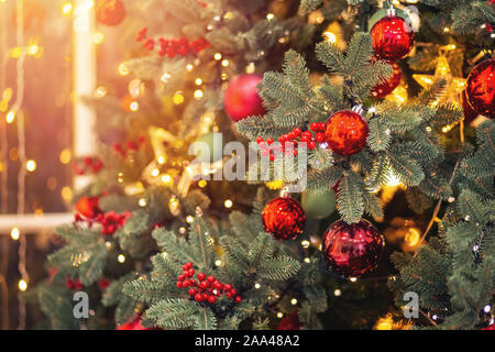 Christmas background banner pine tree branch with decorations red balls star, with bokeh light. - Stock Photo