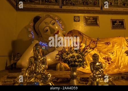 Reclining Buddha image found in a chapel at the Shwedagon Pagoda in Yangon, Myanmar (Burma) - Stock Photo