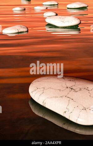Weisse Steine bei Sonnenuntergang, die in einer Linie angeordnet sind, um ueber das Wasser schreiten zu koennen - Stock Photo