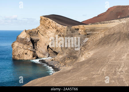 View of the volcanic coastline landscape on the western point of Faial Island, considered as the westernmost point in Europe, formed by the Capelinhos - Stock Photo
