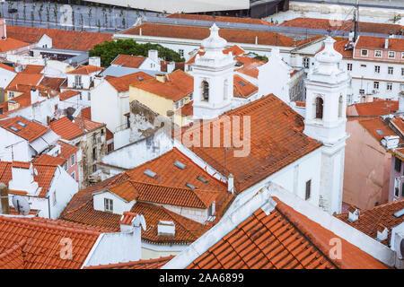 Lisbon, Portugal :  Church of Sao Miguel in the Alfama old town as seen from the Miradouro de Santa Luzia viewpoint. - Stock Photo