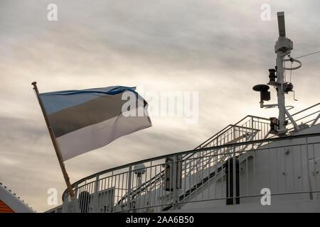 Estonian National flag on a ship to Tallinn Estonia - Stock Photo