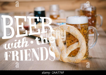 top view of fried sausages, onion rings, french fries, pretzels and mugs with beer on wooden table in pub with beer with the friends illustration - Stock Photo