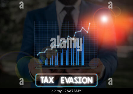Conceptual hand writing showing Tax Evasion. Concept meaning the failure to pay or the deliberate underpayment of taxes - Stock Photo