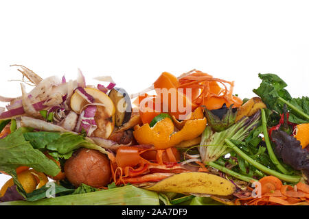 Food Waste. Compostable Food Scraps, time lapse. Domestic food waste for compost from fruits and vegetables on white background. - Stock Photo