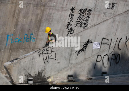 Hong Kong, China. 18th Nov, 2019. (EDITOR'S NOTE: Image contains profanity)Graffiti seen around the campus during the protests. Siege at Polytechnic University. Police surround the university campus after pro-democratic protesters blocked the cross-harbour tunnel and the major road outside the campus. Hong Kong protest continue for the sixth months. A citywide strike called for started on Monday 11 November, 2019 which brought parts of Hong Kong to halt as MTR stations closed and multiple roadblocks were erected. Credit: SOPA Images Limited/Alamy Live News - Stock Photo