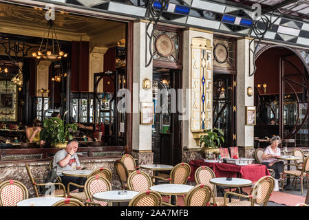 Brussels Old Town / Belgium - 06 25 2019: Art nouveau terrace of the Le Falstaff typical brasserie with glass and steel decorations - Stock Photo