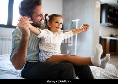 Father and his daughter child girl playing together. Happy loving family - Stock Photo