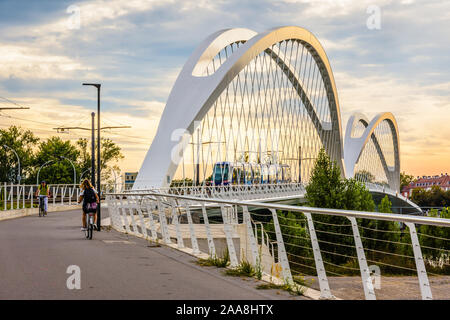 The Beatus Rhenanus bridge allows streetcars, pedestrians and cyclists to cross the river Rhine between Strasbourg in France and Kehl in Germany. - Stock Photo