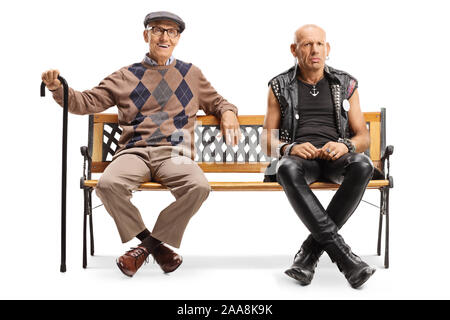 Full length portrait of a senior man with a cane and a punk man sitting on a bench isolated on white background - Stock Photo