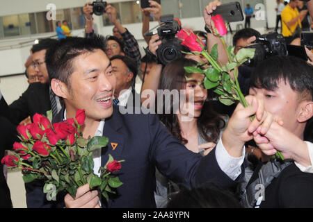 (191120) -- BANGKOK, Nov. 20, 2019 (Xinhua) -- Thailand's Future Forward Party Leader Thanathorn Juangroongruangkit receives flowers from his supporters after arriving at the Constitutional Court in Bangkok, Thailand, Nov. 20, 2019. Thanathorn Juangroongruangkit has lost his MP status due to his alleged holding of a media firm's shares. The Constitutional Court on Wednesday ruled Thanathorn guilty of holding shares of V-Luck Media Co. after he applied in early February to contest the March election for MP. No electoral candidates are legally allowed to hold shares of a media firm. (Xinhua/Rach - Stock Photo