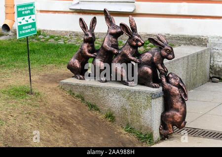 PETERSBURG, RUSSIA-May 5, 2015: Hares during the flood. Sculpture of the rabbits in Peter and Paul Fortress on Hare Island. - Stock Photo