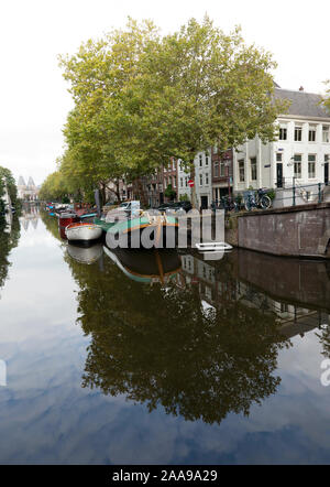A view looking down the Lunbaansgracht Canal, towards the twin-towers of the Rijksmuseum  in the distance, Amsterdam, Holland - Stock Photo