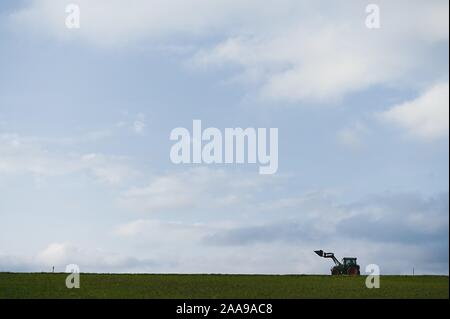 Rattelsdorf, Germany. 20th Nov, 2019. A farmer drives a tractor along a country road. Credit: Nicolas Armer/dpa/Alamy Live News - Stock Photo