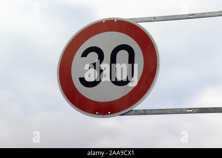 German round, red 30 km/h traffic sign - Stock Photo