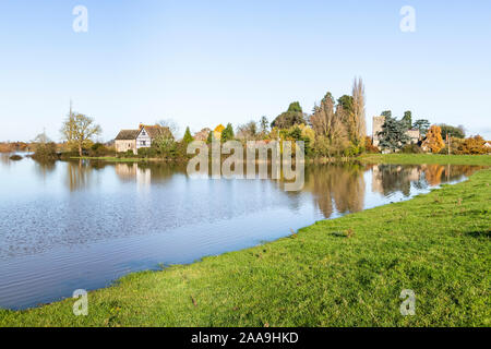 Oddas Chapel & St Marys church with River Severn floodwater filling fields around the Severn Vale village of Deerhurst, Gloucestershire 18/11/2019 - Stock Photo