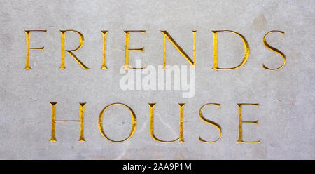 The term or wards Friends House carved in stone in elegant golden lettering - Stock Photo