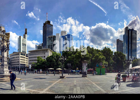 Frankfurt am Main, Germany - July 21, 2017: A panorama showing the skyscrapers of Frankfurt on a warm summer day, all seen from Opernplatz. - Stock Photo