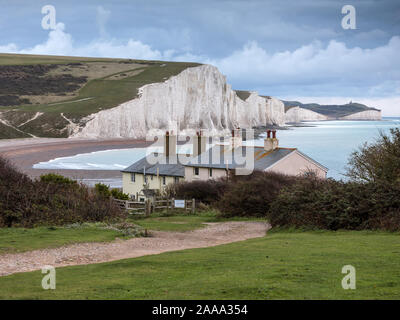 Seven Sisters chalk cliffs and Coastguard Cottages, Cuckmere Haven, Seaford Head Nature Reserve, Seaford, East Sussex, England, UK - Stock Photo