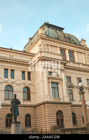 Pilsen, Czech Republic - Oct 28, 2018: The building of the J.K. Tyl Theatre in. House built in the neo-renaissance architectural style with art nouveau elements. Statue of Tyl in the foreground. - Stock Photo
