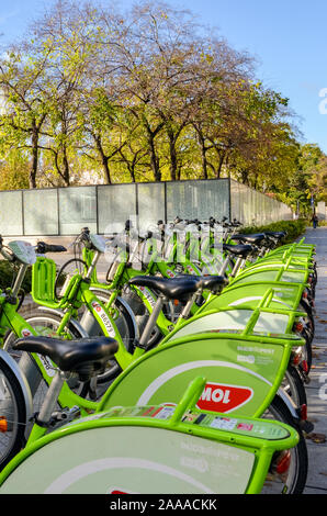 Budapest, Hungary - Nov 6, 2019: Public green bicycles for rental in the centre of the Hungarian capital city. Bike-sharing. Eco-friendly means of transport. Ecological measures in the cities. Bikes. - Stock Photo