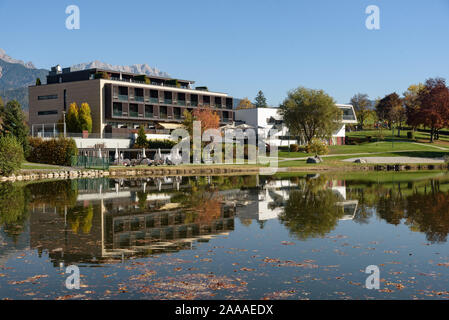 Ritzensee, Saalfelden, Salzburg/Austria, October 26, 2019: View of the nature bath at Ritzensee with the peaks of the Steinernes Meer reflecting in th - Stock Photo
