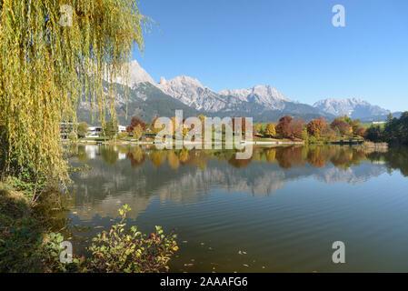View of Lake Ritzensee on a sunny autumn day in Saalfelden with reflection of the Steinernes Meer. Saalfelden, Pinzgau, Salzburg Land, Austria, Europe - Stock Photo