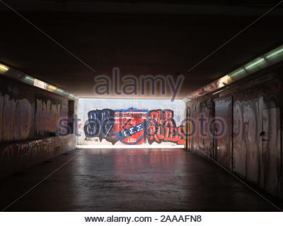 Red and blue graffiti in a pedestrian underpass in Athens, Greece - Stock Photo