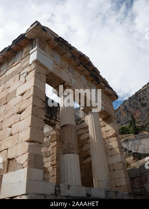 The rebuilt Athenian Treasury with doric columns and stone block construction at Delphi in Greece. - Stock Photo