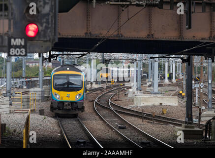 First Transpennine express class 185 and Northern Rail class 150 trains passing outside Manchester Victoria station - Stock Photo