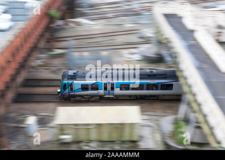 First Transpennine Express class 185 diesel train panned as it departs Manchester Victoria with a  Manchester Airport to Newcastle train - Stock Photo