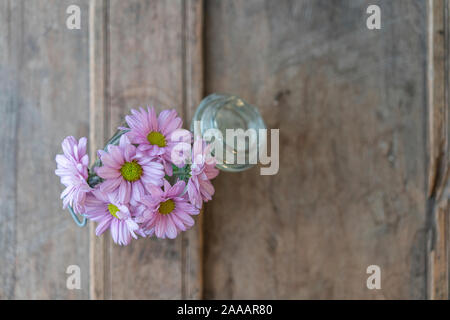 Summer flowers from above  in a glass pot on a  shabby wooden rustic element - Stock Photo