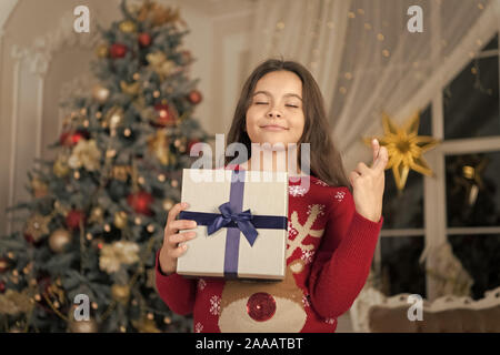 The morning before Xmas. New year holiday. Happy new year. small wishing and dreaming girl at christmas. Christmas. Kid enjoy the holiday. little child girl likes xmas present. best wishes. - Stock Photo