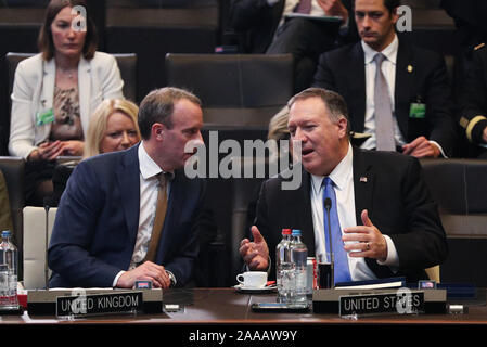 Brussels, Belgium. 20th Nov, 2019. British Foreign Secretary Dominic Raab (L, Front) talks with U.S. Secretary of State Mike Pompeo (R, Front) at the meeting of the North Atlantic Council at the level of foreign ministers at the NATO headquarters in Brussels, Belgium, on Nov. 20, 2019. Foreign ministers of the North Atlantic Treaty Organization (NATO) agreed to include space as its new operational domain alongside air, land, sea and cyber, NATO Secretary General Jens Stoltenberg said Wednesday. Credit: Zheng Huansong/Xinhua/Alamy Live News - Stock Photo