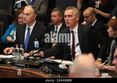 Brussels, Belgium. 20th Nov, 2019. NATO Secretary General Jens Stoltenberg (C) speaks at the meeting of the North Atlantic Council at the level of foreign ministers at the NATO headquarters in Brussels, Belgium, on Nov. 20, 2019. Foreign ministers of the North Atlantic Treaty Organization (NATO) agreed to include space as its new operational domain alongside air, land, sea and cyber, NATO Secretary General Jens Stoltenberg said Wednesday. Credit: Zheng Huansong/Xinhua/Alamy Live News - Stock Photo