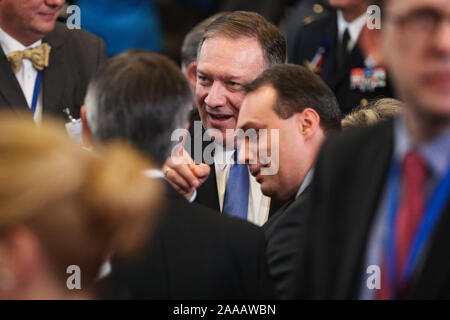 Brussels, Belgium. 20th Nov, 2019. U.S. Secretary of State Mike Pompeo (C) talks with others before the meeting of the North Atlantic Council at the level of foreign ministers at the NATO headquarters in Brussels, Belgium, on Nov. 20, 2019. Foreign ministers of the North Atlantic Treaty Organization (NATO) agreed to include space as its new operational domain alongside air, land, sea and cyber, NATO Secretary General Jens Stoltenberg said Wednesday. Credit: Zheng Huansong/Xinhua/Alamy Live News - Stock Photo
